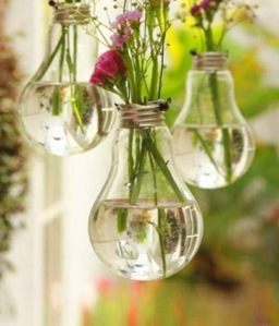 Incandescent lightbulbs become mini hanging vases.  Courtesy of Red Ship.