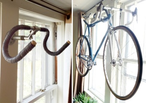 Oh, lovely.  A bike is held by old bike handlebars.  Courtesy of Upcycle That.