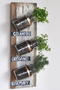 Transform your old jars into a decorative herb garden!  Courtesy of Camille Styles.