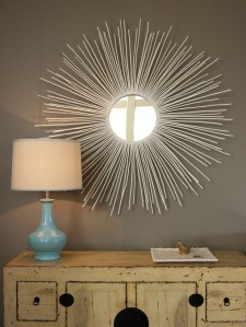 This mirror is made from collected sticks that are painting white and attached to a mirror.  See HGTV on how to do this.